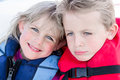 Brother and sister in life jackets on a boat wearing Royalty Free Stock Photography