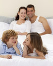 Brother and sister looking at each other in bed Royalty Free Stock Image
