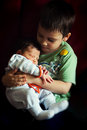 Brother and sister love holding his smaller tight in his arms with great affection Stock Photo