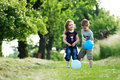 Brother and sister outdoor portrait with balloons Royalty Free Stock Photo