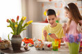 Brother and sister painting Easter eggs Royalty Free Stock Photo