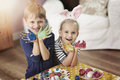 Brother and sister painting easter eggs young creative painters at home Royalty Free Stock Photo