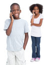 Brother and sister on the phone a white background Royalty Free Stock Photography