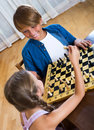Brother and sister playing chess Royalty Free Stock Photo