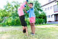 Brother and sister playing in garden two black children doing handstand Royalty Free Stock Images