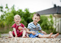 Brother and sister are playing outside Royalty Free Stock Photo