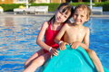 Brother and sister in pool Stock Image