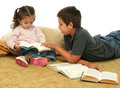 Brother and sister reading books on the floor Stock Image