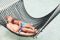 Brother and sister relaxing in beach hammock asleep Royalty Free Stock Image