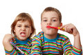 Brother and sister in shirts brush their teeth Royalty Free Stock Photos