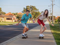 Brother and sister with  skateboard Royalty Free Stock Photo