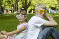 Brother and sister in strange sunglasses Royalty Free Stock Photos
