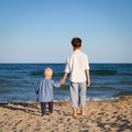 Brother and sister on walk near sea outdoor Royalty Free Stock Photography