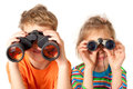 Brother sister watching binoculars white background Royalty Free Stock Photography