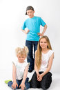 Brother and sisters on white Royalty Free Stock Photography
