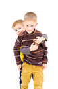 Brotherly protection the younger brother is hiding behind his older brother Royalty Free Stock Image