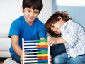 Brothers with abacus Royalty Free Stock Photo