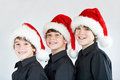 Brothers in christmas hats isolated on white Royalty Free Stock Photography