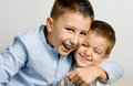Brothers love two young boys hugging each other Stock Photos