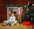 Brothers near christmas tree two decorated pending holiday Royalty Free Stock Photos