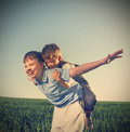 Brothers outdoors happy play two Royalty Free Stock Image