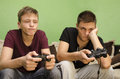 Brothers playing video games boredom two caucasian bored from Royalty Free Stock Image