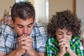 Brothers praying at home two hispanic and having their daily christian devotional young children religious life religious Royalty Free Stock Photography