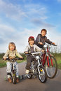 Brothers ride on bikes outdoors Stock Photos