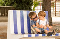 Brothers two little hugging and playing on bench Stock Photography