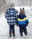 Brothers walking two going for a walk in the winter Stock Image