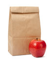 Brown bag lunch with clipping path a red apple isolated a on a white background Royalty Free Stock Photography