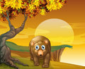 A brown bear beside a big tree near the cliff illustration of Royalty Free Stock Photography