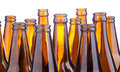 Brown beer bottles stacked isolated on white background a Stock Photo