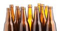 Brown beer bottles stacked isolated on white background a Stock Photos