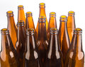 Brown beer bottles stacked isolated on white background a Stock Images