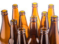 Brown beer bottles stacked isolated on white background a Royalty Free Stock Photography