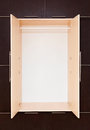 Brown and beige modern wooden wardrobe openly Royalty Free Stock Images