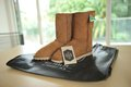 Brown boots ugg sitting on the table Royalty Free Stock Photos