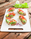 Brown bread with avocado, smoked salmon, boiled egg Royalty Free Stock Photo