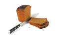 Brown bread and knife Royalty Free Stock Image