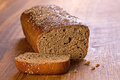 Brown bread on wood background closeup Stock Photos