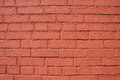 Brown brick wall painted in color Royalty Free Stock Photo