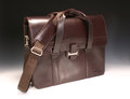 Brown briefcase leather with handles and strap on gradated background Stock Photography