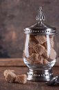 Brown cane sugar cubes in glass vase Royalty Free Stock Photos