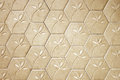 Brown cement block floor flower pattern background. Royalty Free Stock Photo