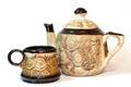 Brown ceramic cofee (tea) cup and teapot Stock Photos