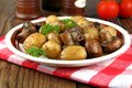 Brown champignons and rosemary potato close up Royalty Free Stock Image