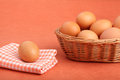 Brown chicken egg on vintage tablecloth and eggs in the basket Stock Images