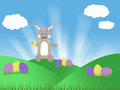Brown chocolate easter bunny with eggs blue sky and green grass spring illustration