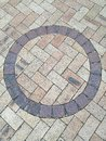 Brown circle shape cobblestone floor Royalty Free Stock Photo